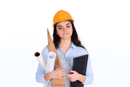 Portrait of female architect holding folders and blueprints with helmet on head. Architect concept. Stock fotó