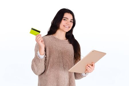 Close-up of a woman with credit card and digital tablet. Shopping, sale concept. Stock fotó