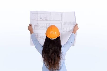 Young female architect holding blueprint. Architect concept.