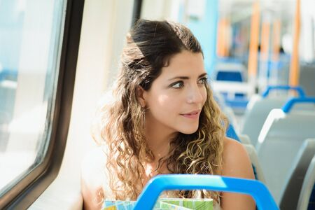 Young woman with map traveling by the train. Enjoying travel concept.