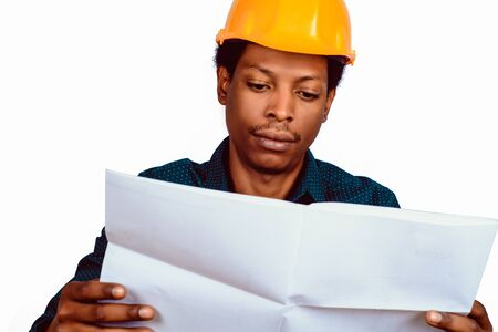 Portrait of Afro american engineer developer in hard hat on gray background. Stock fotó