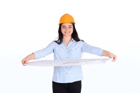Portrait of female architect holding blueprint. Architect concept.