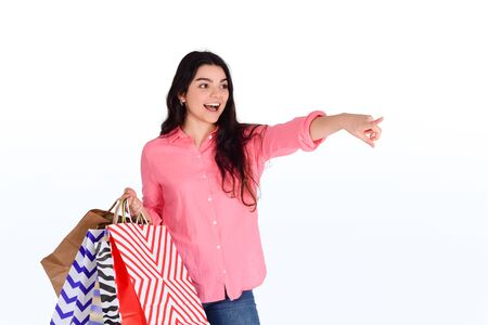Young beautiful woman with shopping bags. Shopping, sale concept. Isolated white background.