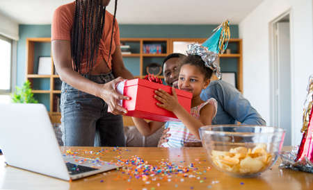 Family celebrating birthday at home. Stock Photo