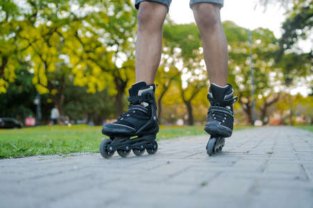Man rollerskating outdoors on the street.