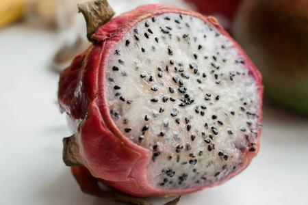 Pitaya fruit (dragonfruit) with black seeds. Closeup photo