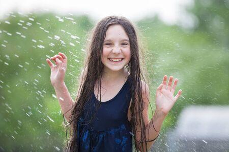 wet dress: girl in wet dress in a spray of water