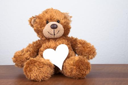 teddy bear background: cute teddy bear with a heart Stock Photo