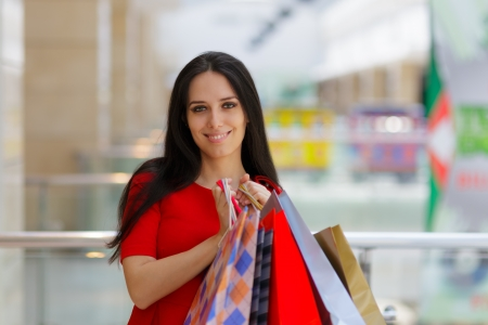 Young Woman Shopping in Mal Holding paper Bags photo