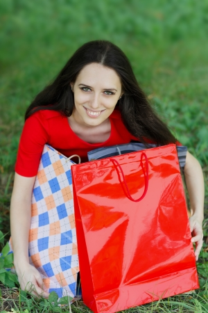 spender: Young Woman Holding Shopping Bags