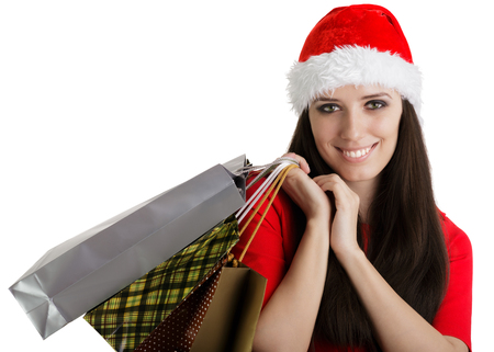 Christmas Girl Carrying Shopping Bags photo