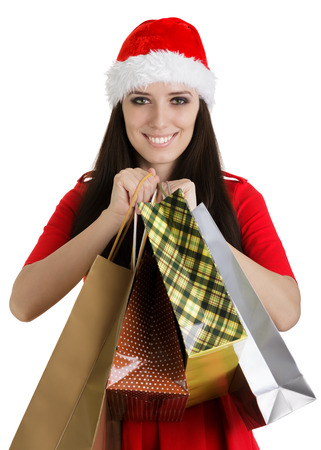 Christmas Girl Holding Shopping Bags photo