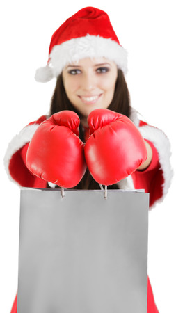 Christmas Girl with Boxing Gloves and Shopping Bags photo
