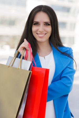 Girl with Shopping Bags Smiling  photo