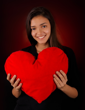 Girl Holding a Big Plush Heart photo