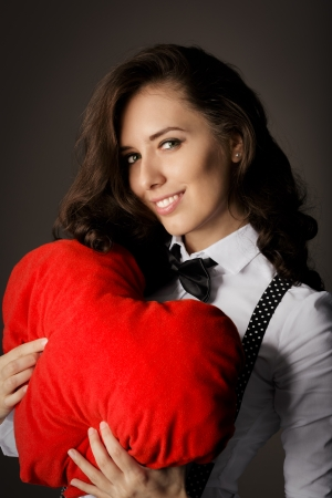 Girl with Heart-Shaped Pillow photo