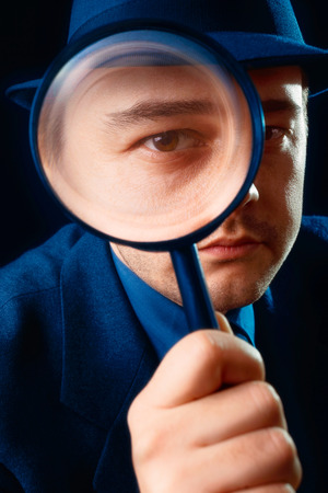 Man Looking through Magnifying Glass  photo