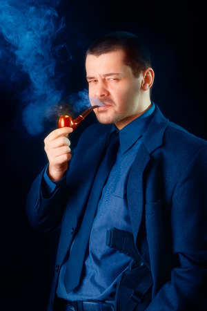 Man with Gun Holstered Smoking Pipe photo