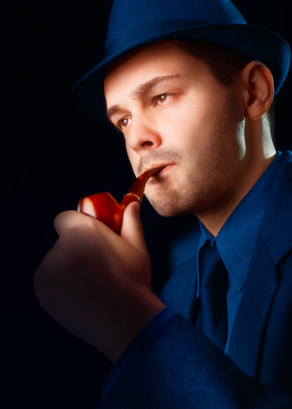 Man with Hat Smoking a Pipe Close Up photo