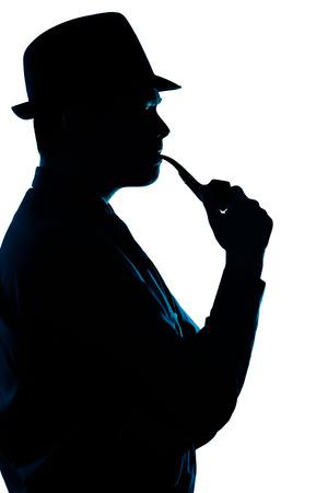 白い背景の上、男性喫煙パイプのシルエット