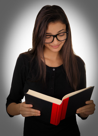 Girl With Glasses Reading a Book photo