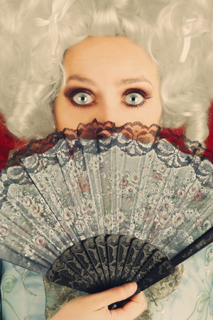 decadence: Surprised  Baroque Woman Portrait with Wig and Fan  Stock Photo
