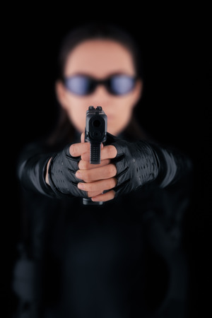Woman Spy Aiming Gun  photo