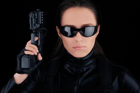 female assassin: Woman Spy Holding Gun