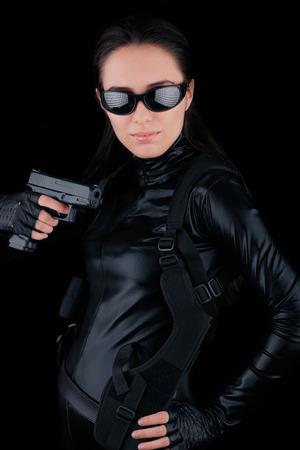 Woman Spy Holding Gun  photo