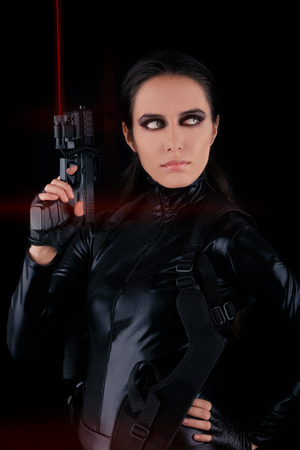 Woman Spy Holding Gun with Laser Sights  photo