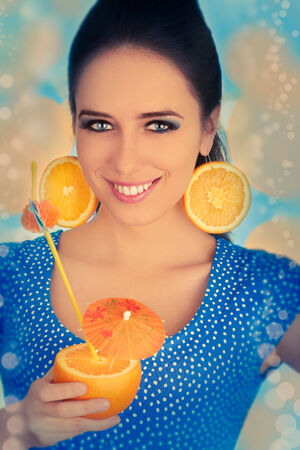Girl with Orange Drink and Orange Slice Earrings  Stock Photo