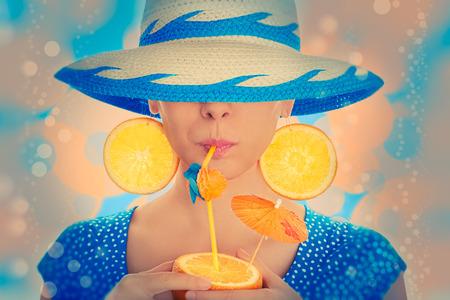 straw hat: Girl with Orange Drink and Orange Slice Earrings Wearing Hat