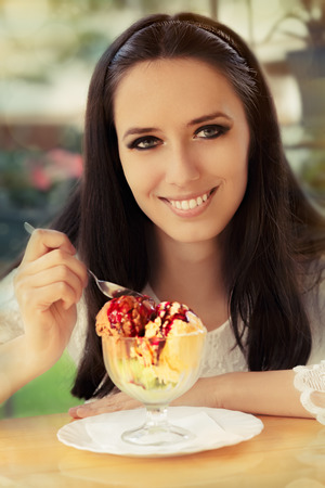 Young Woman Enjoying an Ice Cream Dessert  photo