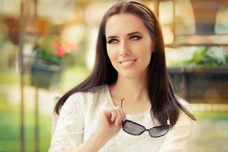 Young Woman Holding Sunglasses  photo