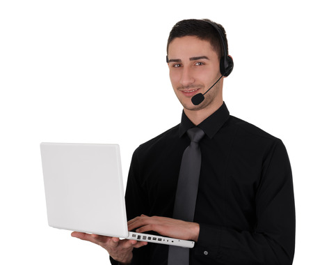 it tech: Call center man with headset and laptop computer on white background