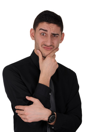 Young man with a funny perplexed expression on his face, isolated on a white background Stock Photo