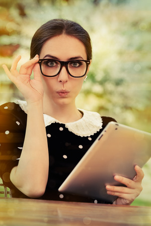 reacting: Surprised Young Woman with Glasses and Tablet