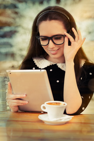 geeky: Young Woman with Glasses and Tablet Having Coffee