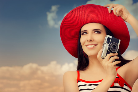 Beautiful Girl with Camera on Blue Sky  photo