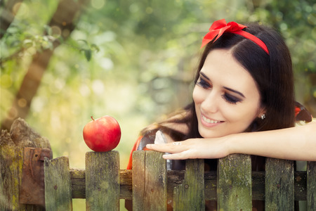 Snow White with Red Apple Fairy Tale Portrait Stock Photo - 30168633