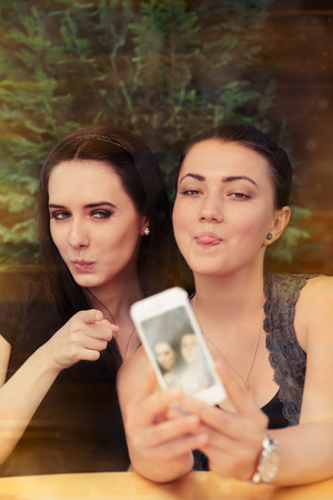 bff: Young Women Taking a Funny Selfie Together