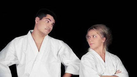 Karate Couple Wearing Kimonos Standing Together  photo