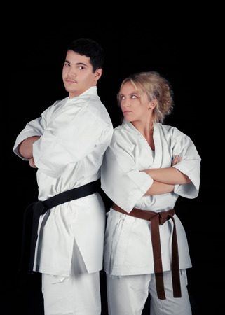 martial artist: Karate Couple Wearing Kimonos Standing Together