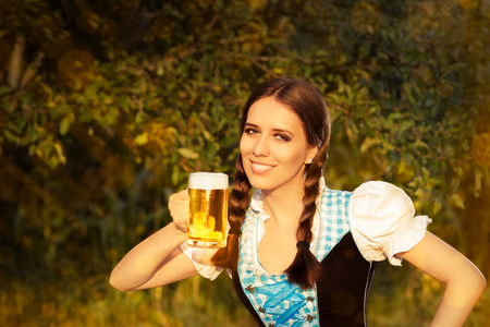 Young Bavarian Woman Holding Beer Tankard  photo
