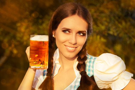 draught: Young Bavarian Woman Holding Beer Tankard