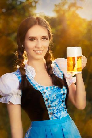 tankard: Young Bavarian Woman Holding Beer Tankard