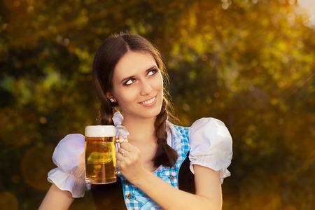 Young Bavarian Woman Holding Beer Tankard  photo