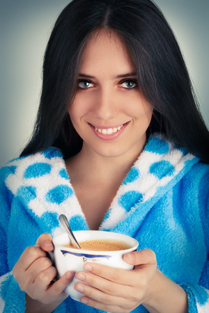 robes: Young Woman in Bathrobe Holding a Big Cup of Coffee