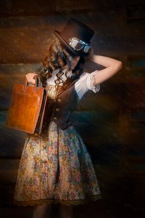 Steampunk Girl with Leather Portfolio Bag photo