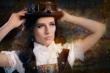 Steampunk Girl with Top Hat and Aviator Glasses photo